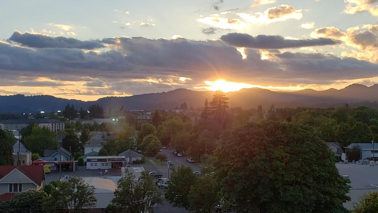 Photograph of sun setting over the mountains